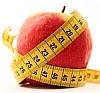 Abnehmen: Apfel mit Maßband